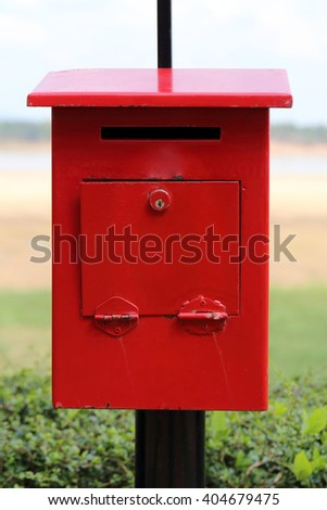 Old red mailbox. - stock photo