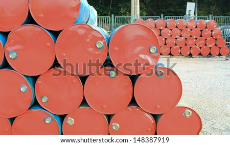 old red oil barrell in the dock background crude oil price in hong kong china - stock photo