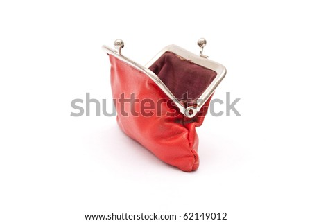 Old red purse against - stock photo