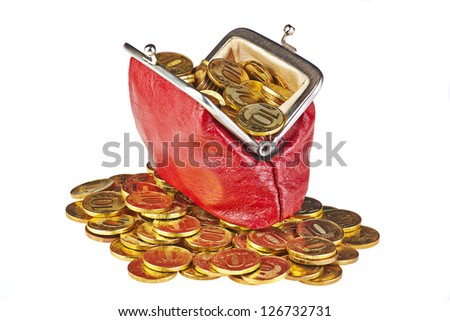 Old red purse and golden coins. Isolated on white background. - stock photo