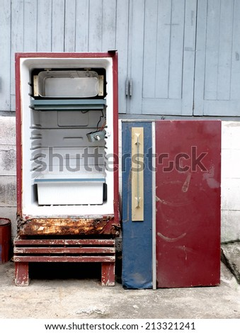 Old red refrigerator are dirty, defective, unavailable ready to out of stock. - stock photo