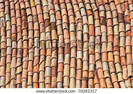 Old red roof clay tiles background