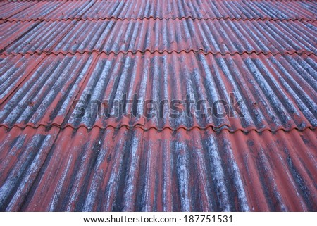 Old red rust iron roof background - stock photo