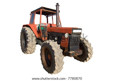 old red rusty tractor with dirty wheels - stock photo