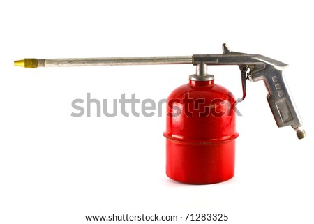 Old red spray gun isolated over white background - stock photo