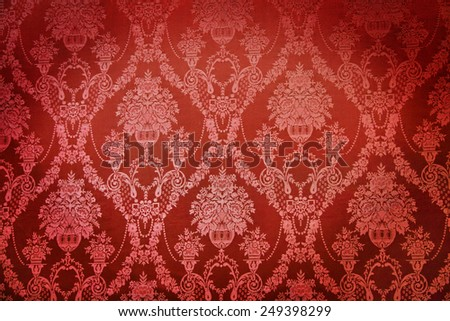 Old red textile wall covering in a palace - stock photo