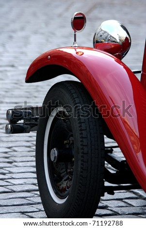 old red vintage car in downtown of Prague - stock photo