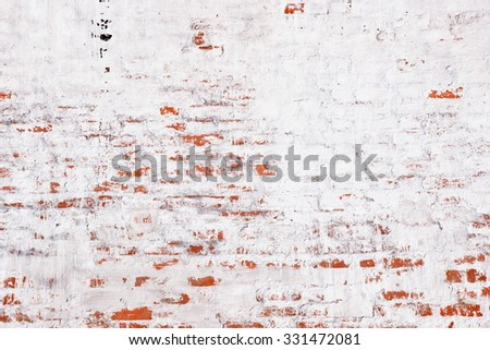 Old Red Whitewashed Brick Wall With Damaged Plaster Background Texture - stock photo