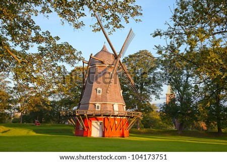 Old red windmill in the Copenhagen, Denmark - stock photo