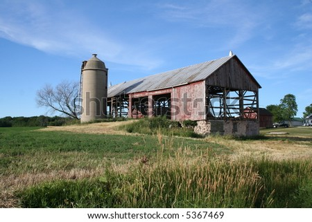 old red Wisconsin barn framework - stock photo