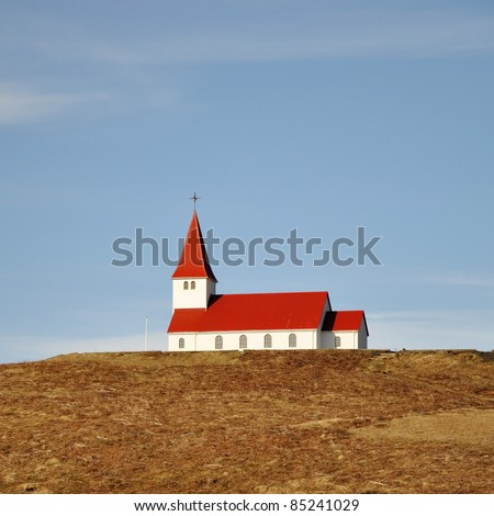 Old red wooden church, Iceland - stock photo