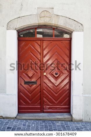 Old red wooden door in Zurich, Switzerland - stock photo