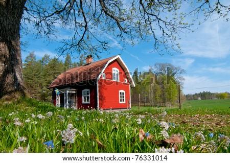 Old red wooden house in Sweden - stock photo