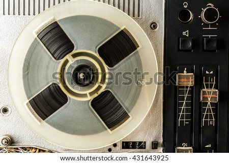 Old reel tape recorder in closeup used - stock photo