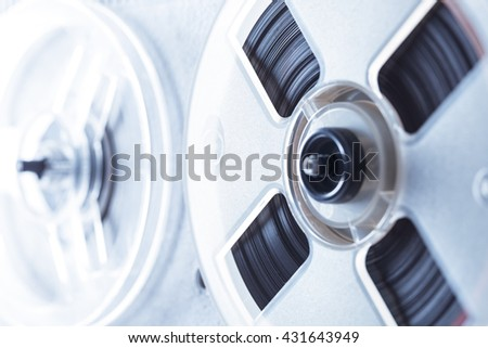 Old reel tape recorder in toning closeup - stock photo