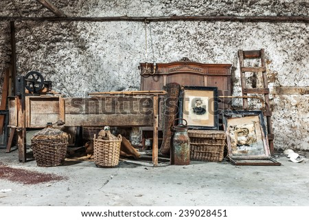 Old relics in a dusty attic - stock photo