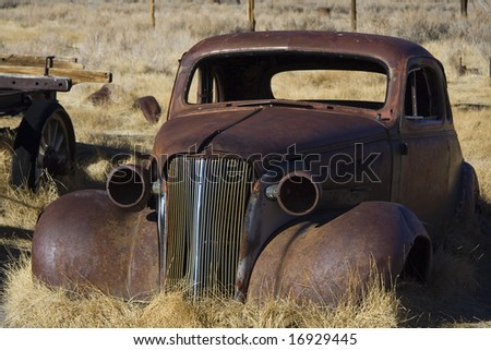 Old remains of car - stock photo