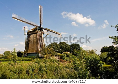 Old Rembrandts windmill by Amstel river - stock photo