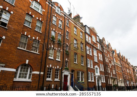 Old residential tenement houses in London. - stock photo