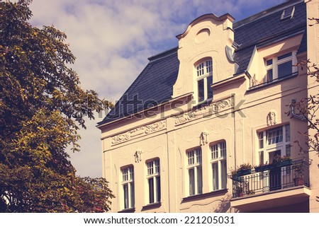 Old Restored Residential House in Berlin with a retro vintage instagram filter effect - stock photo