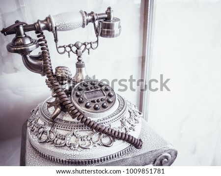 Old retro antique phone decorate as interior - vintage color processing