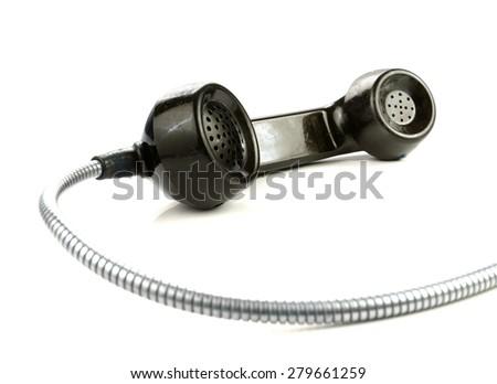 Old retro bakelite earphone. On a white background - stock photo