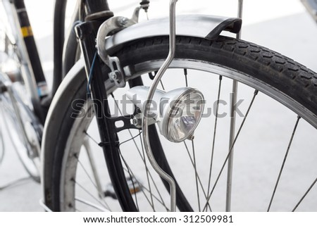 Old retro bicycle, front wheel and headlight