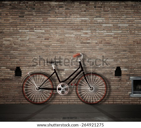 old retro bicycle leaning against a wall - stock photo