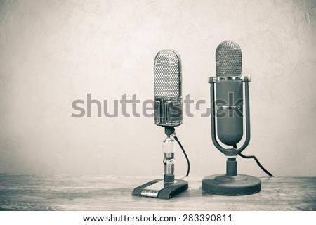 Old retro big ribbon microphones from 50s on table. Vintage style sepia photo - stock photo