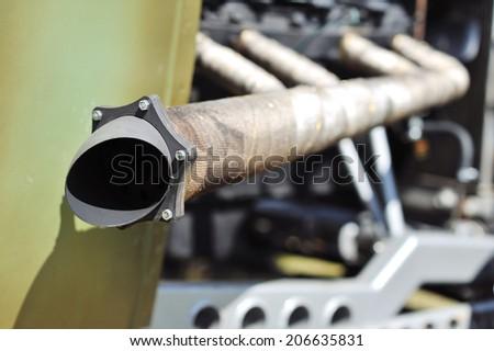 Old retro car exhaust system muffler - stock photo