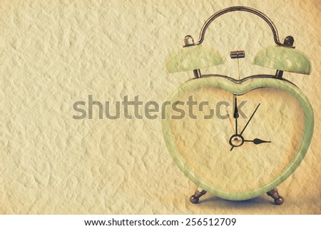 old retro clock on mulberry paper background ,abstract background to memory of last time. - stock photo