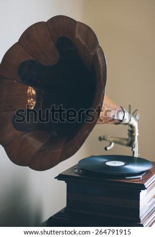 Old retro gramophone indoor - stock photo
