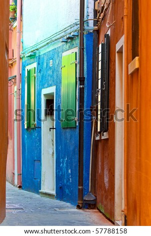 Old retro grunge house in a narrow street - stock photo