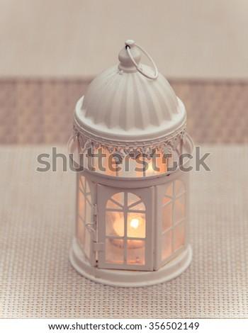 old, retro kerosene lamp isolated on white background - stock photo