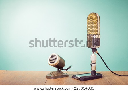 Old retro microphones front gradient mint green background - stock photo