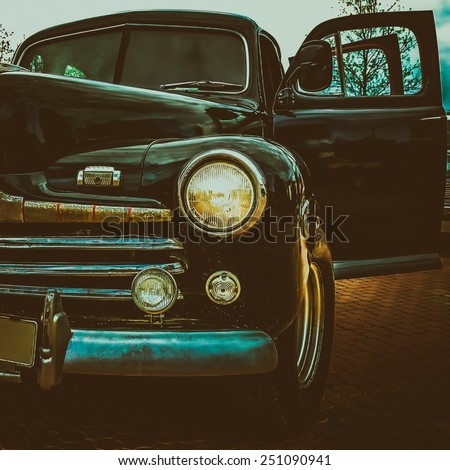 Old retro or vintage car or automobile front side with front lights or headlights and radiator grill. Processed by vintage or retro effect filter - stock photo