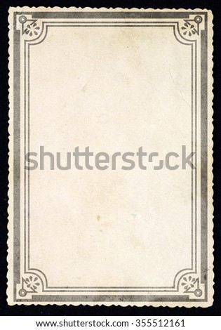 Old retro paper sheet with ornamental frame, isolated on black background.