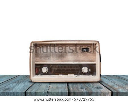 Old retro radio on blue wood table with white background
