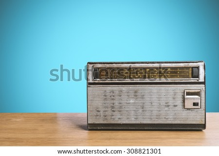 Old Retro radio on table with pastel background