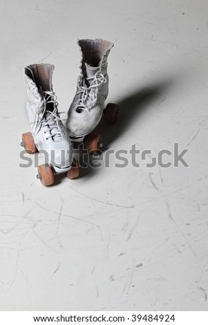 Old retro roller skates front view - stock photo