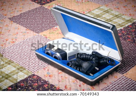 Old retro shaver machine  in the box over abstract background - stock photo