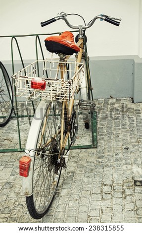 Old retro styled bicycle with empty metal basket. - stock photo