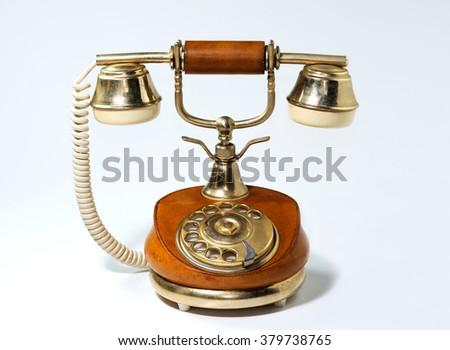 Old retro telephone on white background - stock photo