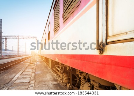 Old retro train stopped at the small station  - stock photo