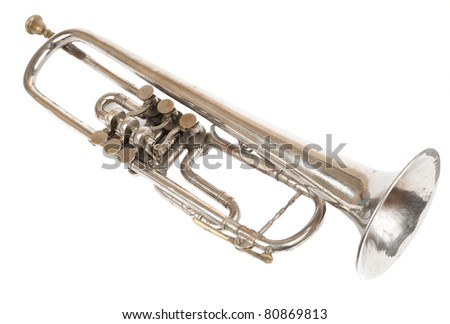 Old retro trumpet isolated over white background