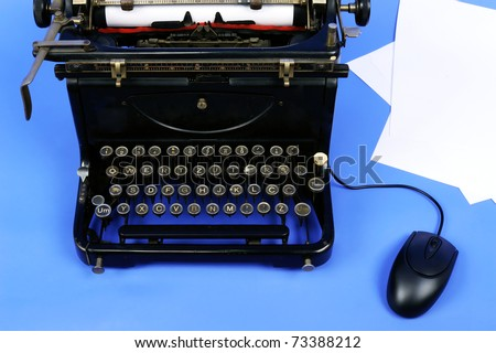 Old retro typewriter with paper sheets and computer mouse