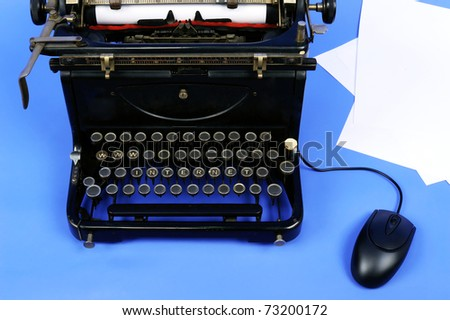 Old retro typewriter with www and internet text, paper sheets and computer mouse