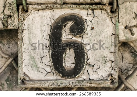 Old retro weathered painted cast iron plate with number 6 - stock photo