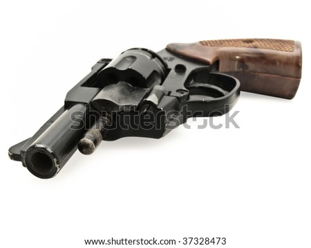 old revolver against the white background - stock photo