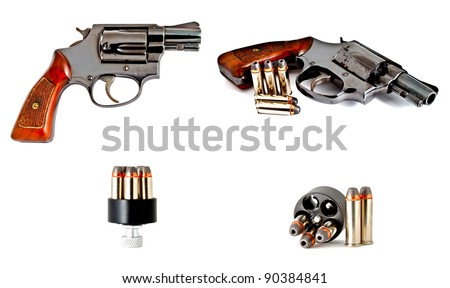 old 0.38 revolver handgun with a set of bullet in speed loader device, studio shot - stock photo